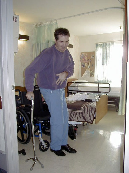 Tom rising from his wheelchair.